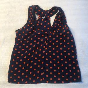 Navy and tangerine polka dot sleeveless blouse